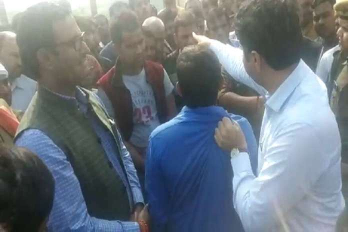 Amethi DM Prashat Sharma seen dragging a man by his shirt in viral video