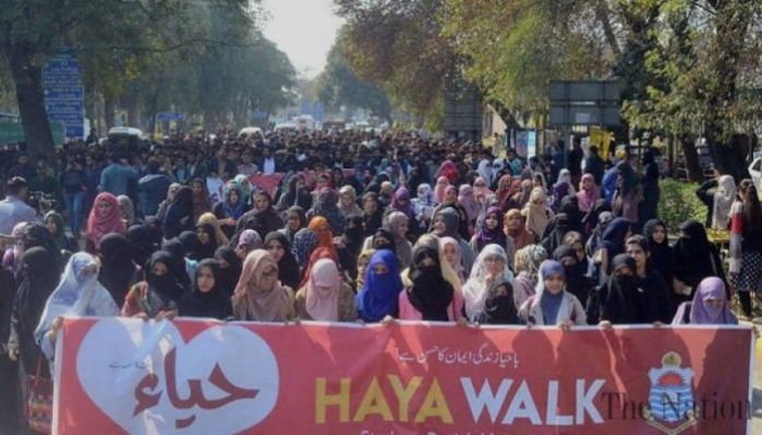 Burkha Clad Women protests against Aurat March that aims to secure them