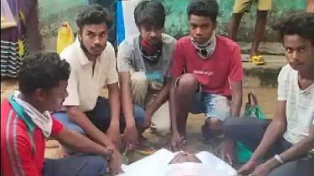 Having denied a place for burial in a Christian cemetery, family perform the last rites of the deceased by cremating the body with HIndu rituals