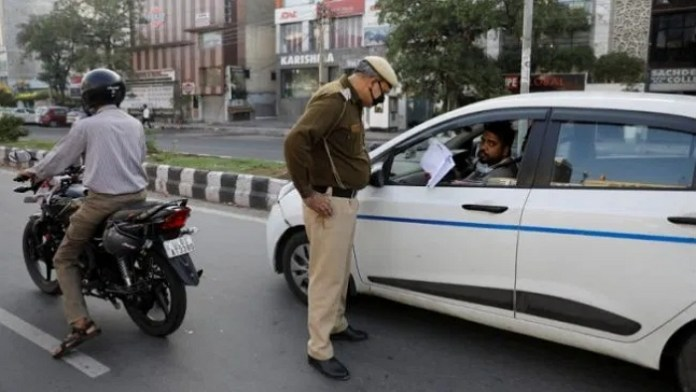 Car passenger shows Lockdown Pass to cop- File Photo