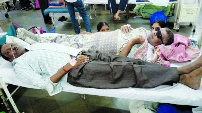Mumbai's healthcare system faces the pressure as reports say patients are being made to share beds