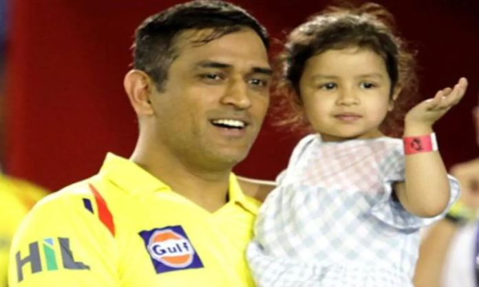 Dhoni with his daughter
