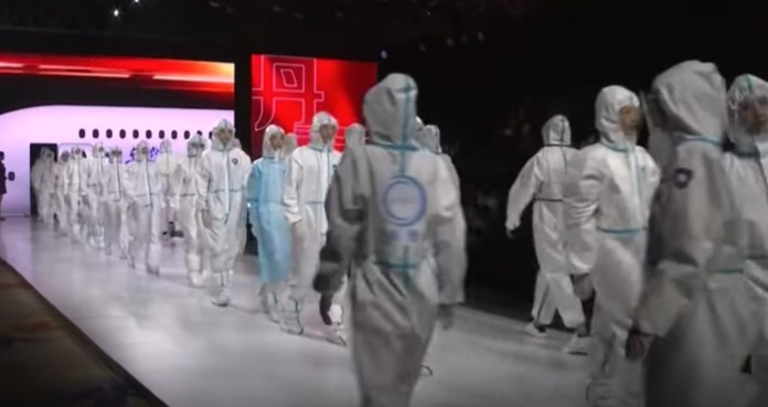 After exporting coronavirus to the entire world, China organises fashion show to showcase hazmatsuits that have found to be faulty