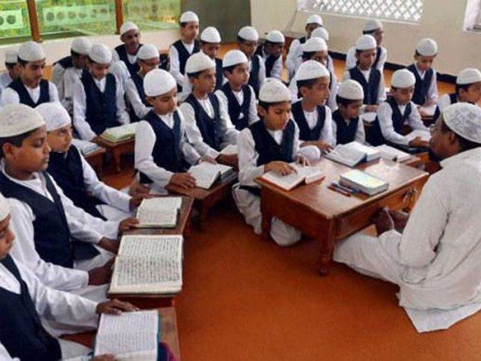Is the government forcing madarsas to teach Ramayana and Vedas?