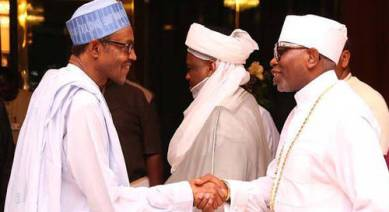 Presidet Muhammadu Buhari shakes hand with President of the Christian Association of Nigeria, Ayo Oritsejafor