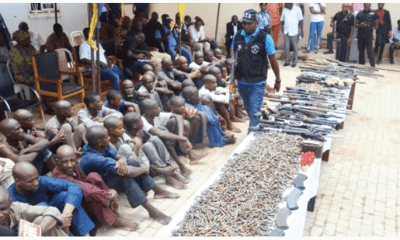 Suspected kidnappers armed robbers gun runners and dealers of illegal weapons from Libya and Chad being paraded by the Nigeria Police Force at the SARS office in Abuja