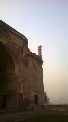 The broken minaret atop and withered layers on the Iwan exposing bricks, plaster and remnant tiles