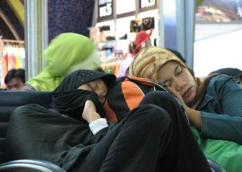 Muslim women sleeping in airport