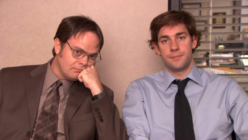 JIM AND Dwight, two salesmen sitting next to each other, one is bored one is amused, business, businessman, ties