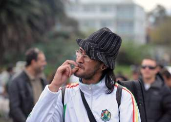 A man smokes marijuana during the World Day for the Legalization of Marijuana on May 3, 2014 in Montevideo. Uruguay Friday said that consumers can purchase up to 10 grams of marijuana per week at less than $1 per gram, as the country embarks on a unique experiment in drug regulation.  AFP PHOTO / Miguel ROJO