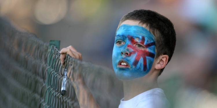 A young fan of Australia's team, with the Australian flag painted onto his face, watches the game Australia vs South Africa during a one-day international triangular series cricket match at the Harare Sports Club on September 2, 2014. AFP PHOTO/JEKESAI NJIKIZANA / AFP / JEKESAI NJIKIZANA