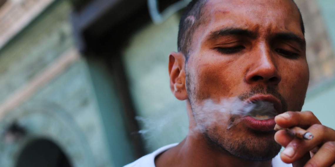 "NEW YORK, NY - AUGUST 05: A man smokes K2 or ""Spice"", a synthetic marijuana drug, along a street in East Harlem on August 5, 2015 in New York City. New York, along with other cities, is experiencing a deadly epidemic of synthetic marijuana usage including varieties known as K2 or ""Spice"" which can cause extreme reactions in some users. According to New York's health department, more than 120 people visited an emergency room in the city in just one week in April. While the state banned the ingredients used to make K2 in 2012, distributors have switched to other ingredients and names in an attempt to circumvent the law.   Spencer Platt/Getty Images/AFP"