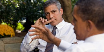 President Barack Obama talks about Sudan with actor George Clooney during a meeting outside the Oval Office, Oct. 12, 2010.  (Official White House Photo by Pete Souza) This official White House photograph is being made available only for publication by news organizations and/or for personal use printing by the subject(s) of the photograph. The photograph may not be manipulated in any way and may not be used in commercial or political materials, advertisements, emails, products, promotions that in any way suggests approval or endorsement of the President, the First Family, or the White House.