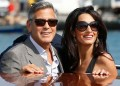 FILE - In this Sept. 26, 2014 file photo, George Clooney, left, and Amal Alamuddin arrive in Venice, Italy. Clooney, 53, and Alamuddin, 36, married in Venice, one of the world's most romantic settings. (AP Photo/Luca Bruno, File)