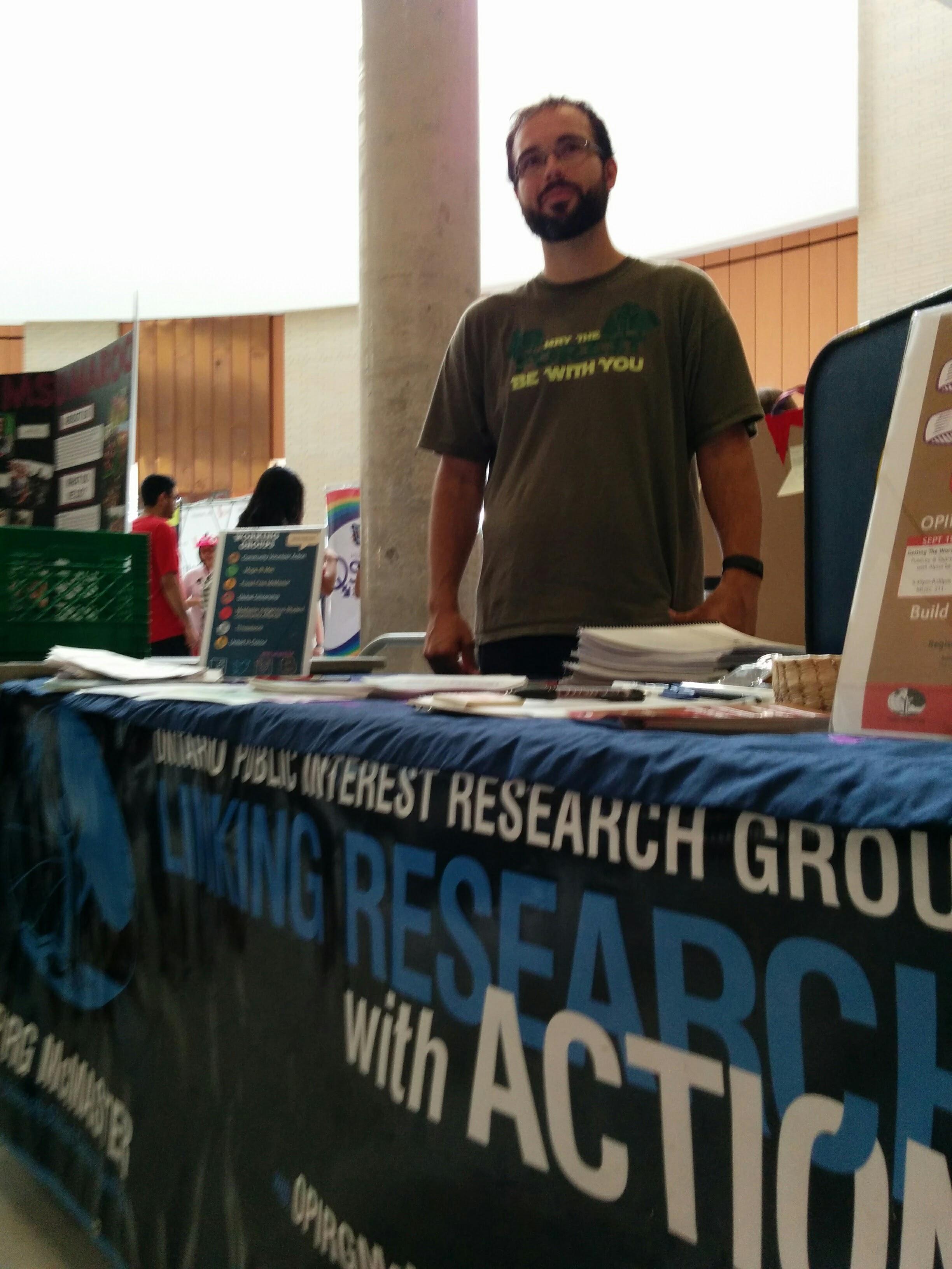 Display table with volunteer