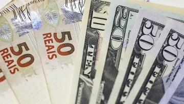 Notas de dólar e real em foto ilustrativa