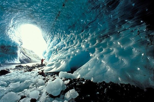 Man standing in an ice cave of the Kverkjoekull Glacier in the Kverkfjoell mountains, highlands, Iceland, Europe