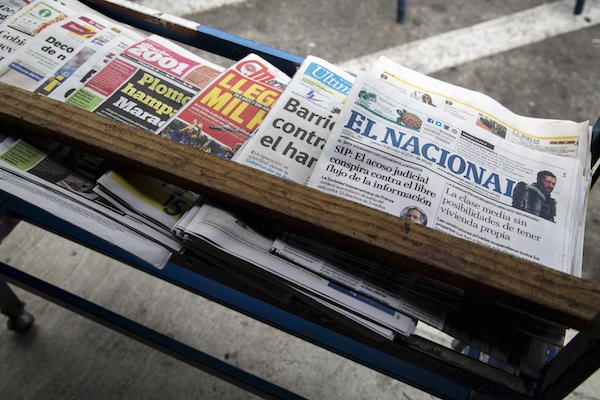 Copy of the El Nacional newspaper is seen among others on a shelf at a kiosk in Caracas