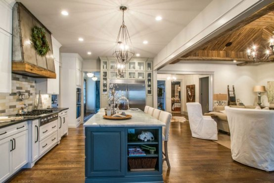 Kabinart Cabinets. Hood wall – Arts and Crafts door style, painted Aspen White. Refrigerator wall – Arts and Crafts door style, painted Limestone. Island – Lancaster door style, painted Atlantic w/ Onyx glaze.