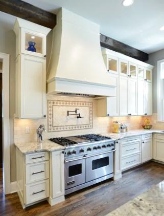 Kabinart Cabinets. Wakefield door style, painted Starlite w/ Chocolate glaze. Custom Hood by Opus.