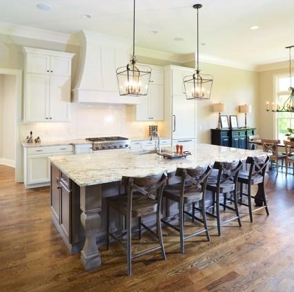 Kabinart Cabinets. Kitchen Perimeter – Hampton door style, custom painted finish: SW7012 Creamy. Custom hood by Opus. Kitchen Island – Hampton door style, cherry wood, stained Boulder.