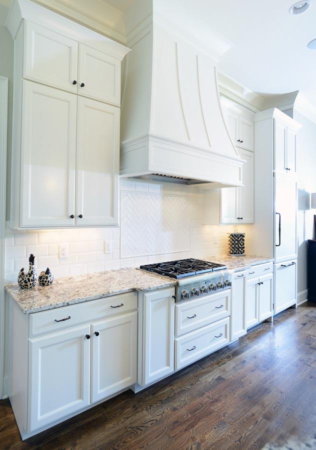Kabinart Cabinets. Hampton Door Style, Custom Painted Finish SW7012 Creamy.  Custom Hood By