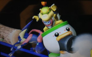 Bowser passes by an unsuspecting Greninja.