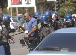 Police hitting Journalist