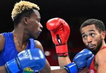 Samuel Takyi wins bronze in men's featherweight bout