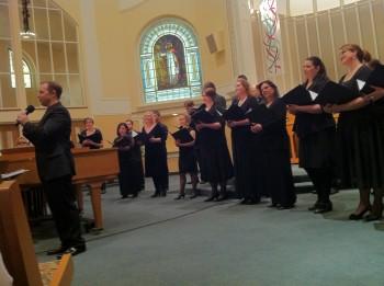 Ryan Heller directed Portland Vocal Consort in its April concert.