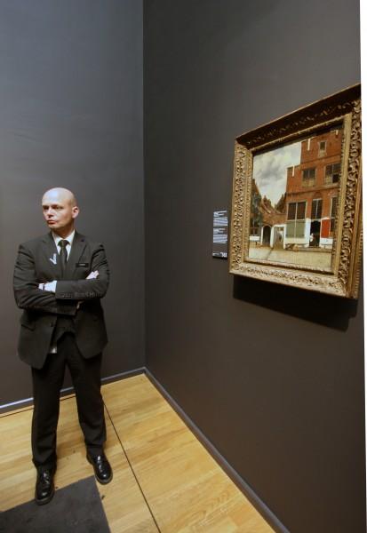 """On guard: standing watch over Johannes Vermeer's 1658 """"The Little Street."""" Photo: Henk Pander"""