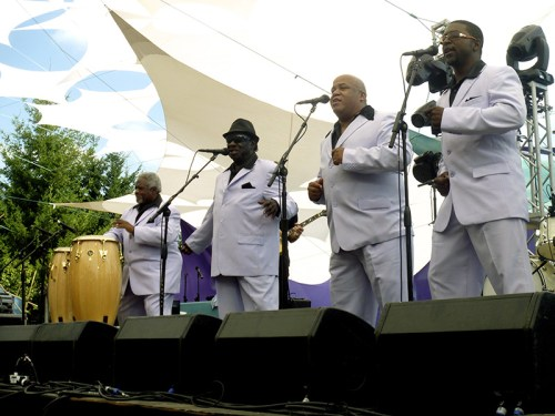 """The Relatives, formed in Dallas in 1970 and revived in 2009, kick it old-school with choreographed dancing, matching lavender suits, and occasional exclamations of """"Ow!"""" and """"Good God!"""""""