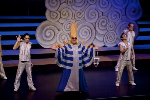 "Soloist Doug Bom and the Locomotions light the menorah during a Hannukah-themed version of ""Edge of Glory"" during the 2011 Portland Gay Men's Chorus holiday concert. Photo: Bill Barry, BarryFoto©."