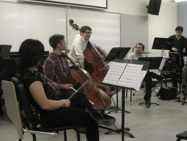 The Fireworks Ensemble (Brian Coughlin, bass) conducts a reading session of OCF student work. February 22, 2014.