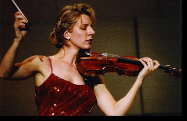 Elizabeth Pitcairn plays the Red Violin with the Columbia Symphony this weekend.