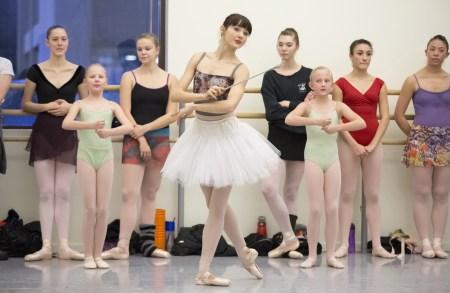 Eva Burton as the Sugarplum Fairy, rehearsing with ballet school students. Photo: Blaine Truitt Covert