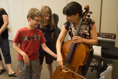 Oregon Symphony cellist Nancy Ives gets up close and personal with young fans at a Classical Up Close event.