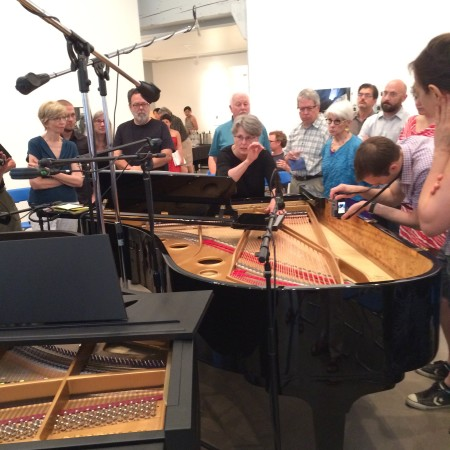 Pianist Deborah Cleaver shows audience members how to get that special Crumb sound.