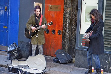 Buskers play folk music in Dublin, Ireland. This lively street is one of their usual stages.
