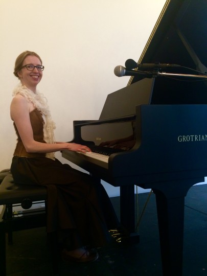 Elbows in: Christina Kobb demonstrates 19th century piano posture. Photo: