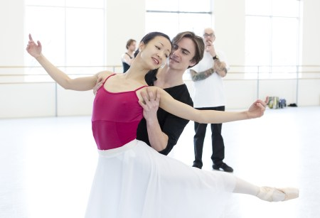 """Xuan Cheng as """"Juliet"""" and Peter Franc as """"Romeo"""" with choreographer James Canfield (in the background) in rehearsal for Oregon Ballet Theatre's production of Romeo and Juliet. Photo by Blaine Truitt."""