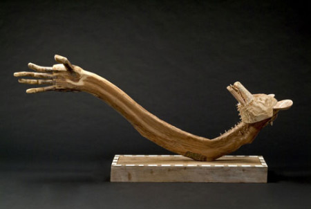 """""""From Nothing Coyote Creates Himself,"""" 2004. Carved wood , 41 x 84 x 16 inches"""