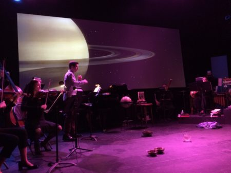 Neist conducts and performs in 'The Overview Effect.'