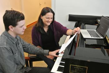 6_Photo: Caption: Composer, Educator Andrea Reinkemeyer with composition student Grey Patterson. Photo: Ehren Cahill.