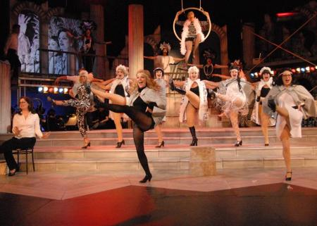 "The company kicks it up in ""Folies Bergere."" Triumph Photography"