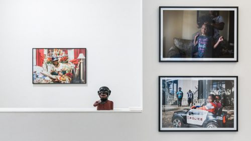 Three photographs by Marian Carrasquero, with figurine. Upfor Gallery.