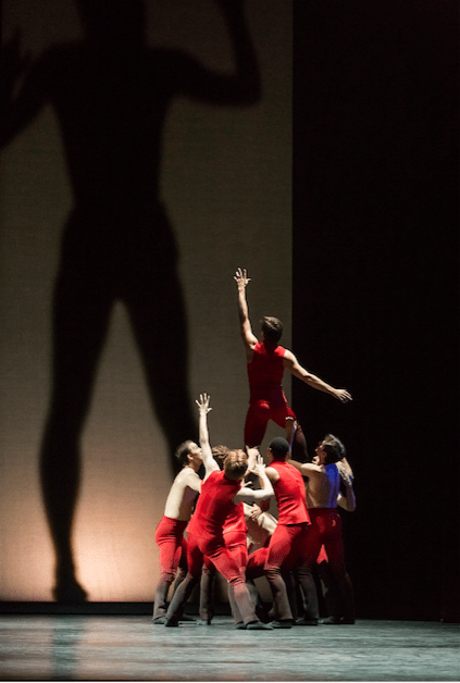 """Michael Linsmeier with other dancers and a large shadow in """"Giants Before Us."""" Photo: Blaine Truitt Covert"""