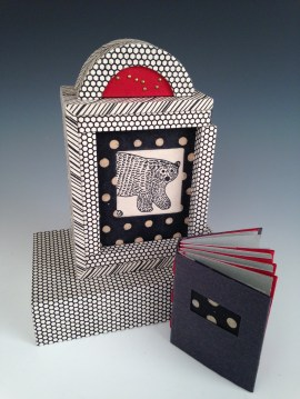 """Margo Klass' """"Ursa Major: The Great Bear in the Sky"""" is a mixed media piece including a tacket-bound (exposed binding) book in box casement with sliding door and base."""