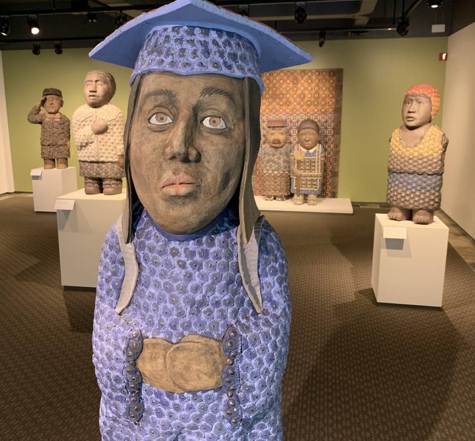 """""""Dreamer,"""" by George Rodriguez, greets visitors at the Hallie Ford Museum of Art as they enter the chamber featuring the sculpture series """"Sanctuary"""" (2017, stoneware with glass, courtesy of the artist and the Foster/White Gallery in Seattle). Photo by: David Bates"""