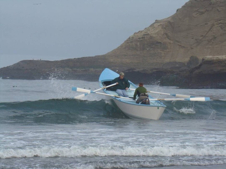 Originally, Pacific City fishermen rowed the flat-bottomed dory boats out to sea, and some continue to fish with them. Photo courtesy: Pacific City Dorymen's Association